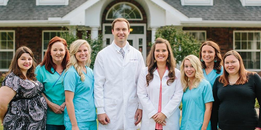 Dr. Gavin Trogdon, DDS with his staff at Farmington Dental Center in Farmington, AR