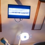 A flatscreen TV in a patient care room.