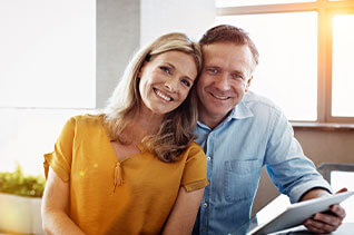 Couple smiling with notepad
